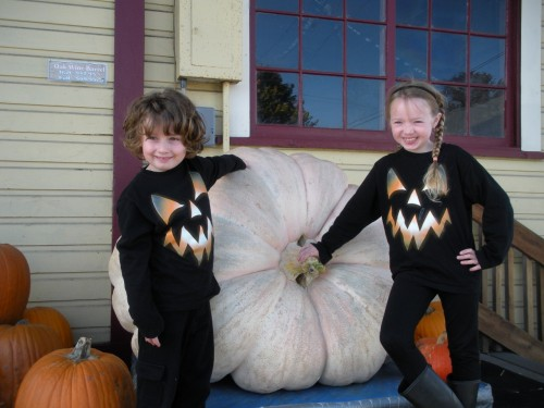 An American Dream Fairytale: Silly, simple, perfect children with their pumpkins