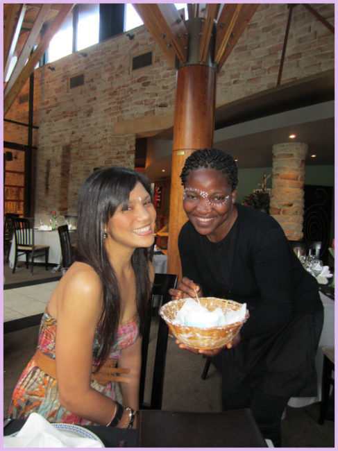 Dreamers Share World Heritage Sites in South Africa: A beautiful waitress paints a 29 on my face