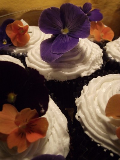 Devil's food cupcakes with vanilla bean frosting and edible garden flowers