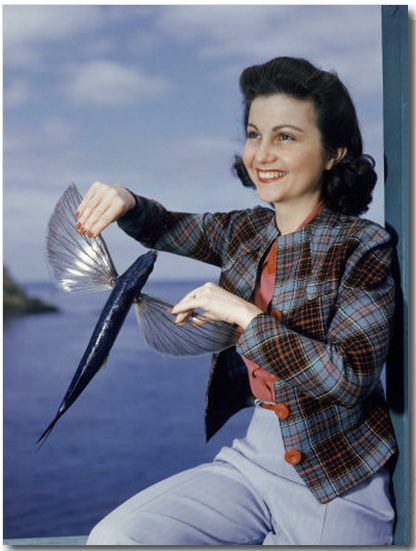 Worst Products: Woman Poses for a Photo with a Flying Fish in Her Hands buy at Art.com