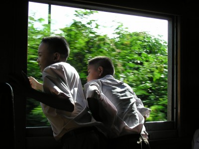 Top Travel Photos: Boys on a train in Kanchanaburi Thailand by Natasha vonGeldern