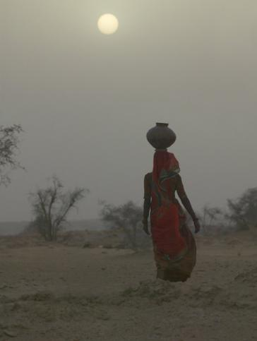 Top Travel Photos: Woman Carrying Water Jar in Sand Storm, Thar Desert, Rajasthan, India By Keren Su - Buy at Art.com