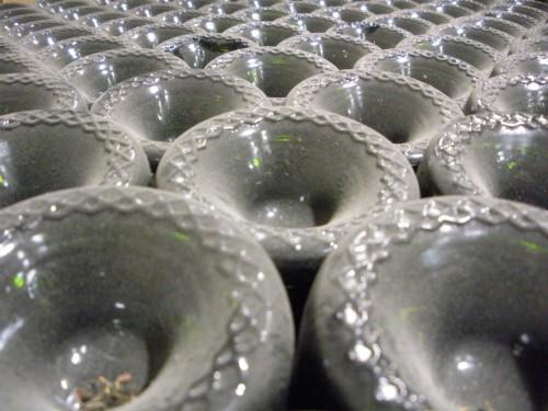 Making Wine: Dusty bottoms in the tirage bin