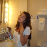 Teenage girl primping in the bathroom