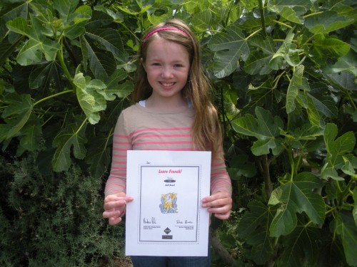 Going for Gold: Sweet petite with her gold award for French:)