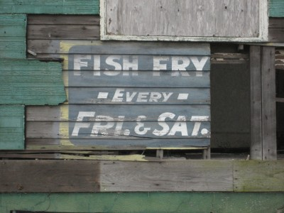"""New Orleans: Weathered old sign on side of building Uptown, advertising """"Fish Fry"""" held every Friday and Saturday"""