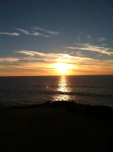 Developing Dreams looking at a sunset over the water on the Pacific coast