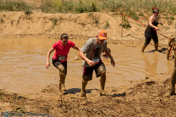 Heather and Jake crawling out of mud pit