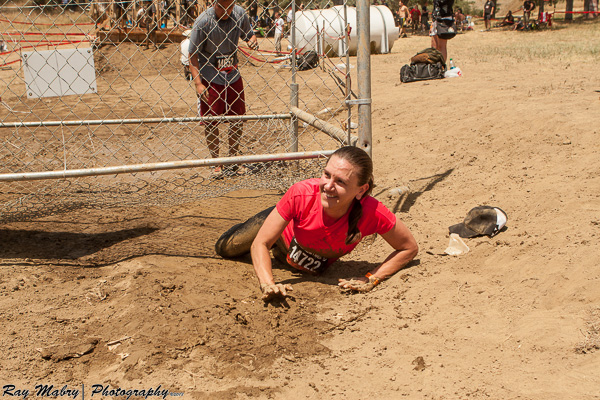 Heather crawline out of the zombie run
