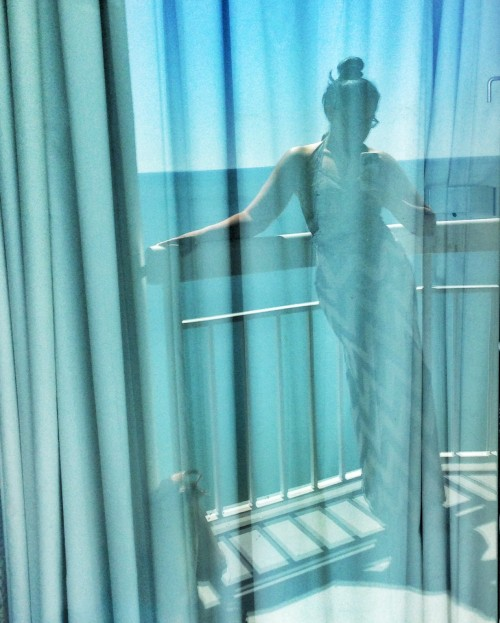 On a recent vacation I saw my reflection in the the porch door and thought my makeshift beachwear of suit under maxi skirt looked awesome.