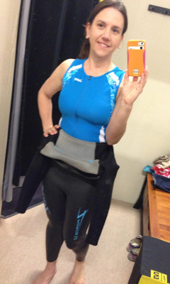 Heather trying on wetsuite for triathlon